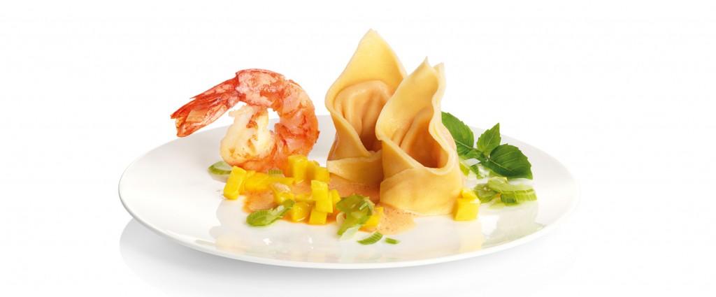 Cappelletti con langostinos en salsa Tandoori
