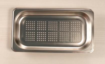 Recipiente para cocinar en un horno de vapor.